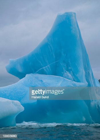 BLUE ICEBERG IN SOUTH GEORGIA IN THE SOUTH ATLANTIC : Stock Photo