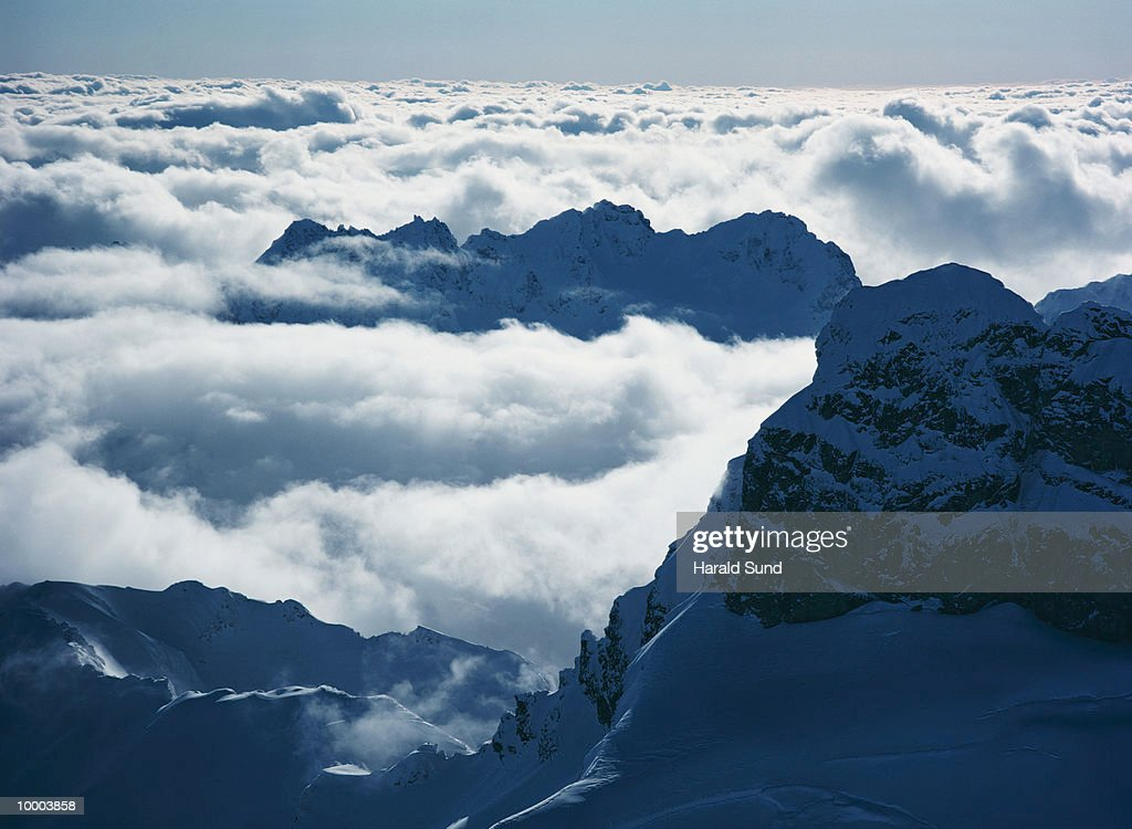 AERIAL OF CLOUDS & CASCADE MOUNTAINS IN WASHINGTON : Stock Photo