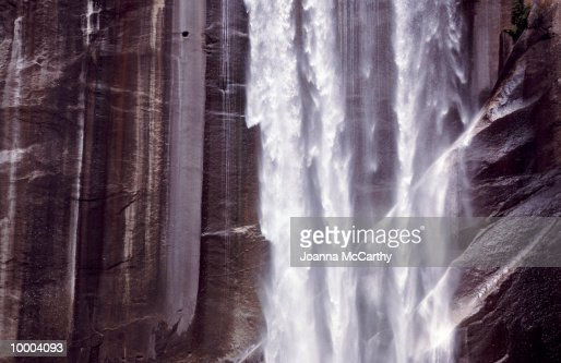 WATERFALL BY CLIFF WALL : Stock Photo