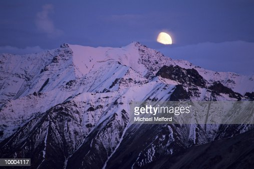 MOUNT PEAKS & MOON AT DENALI NATIONAL PARK IN ALASKA : Stock Photo