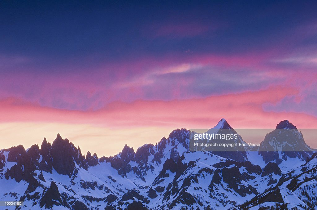SNOWY MOUNTAIN PEAKS UNDER BLUE & PINK SKY : Stock Photo