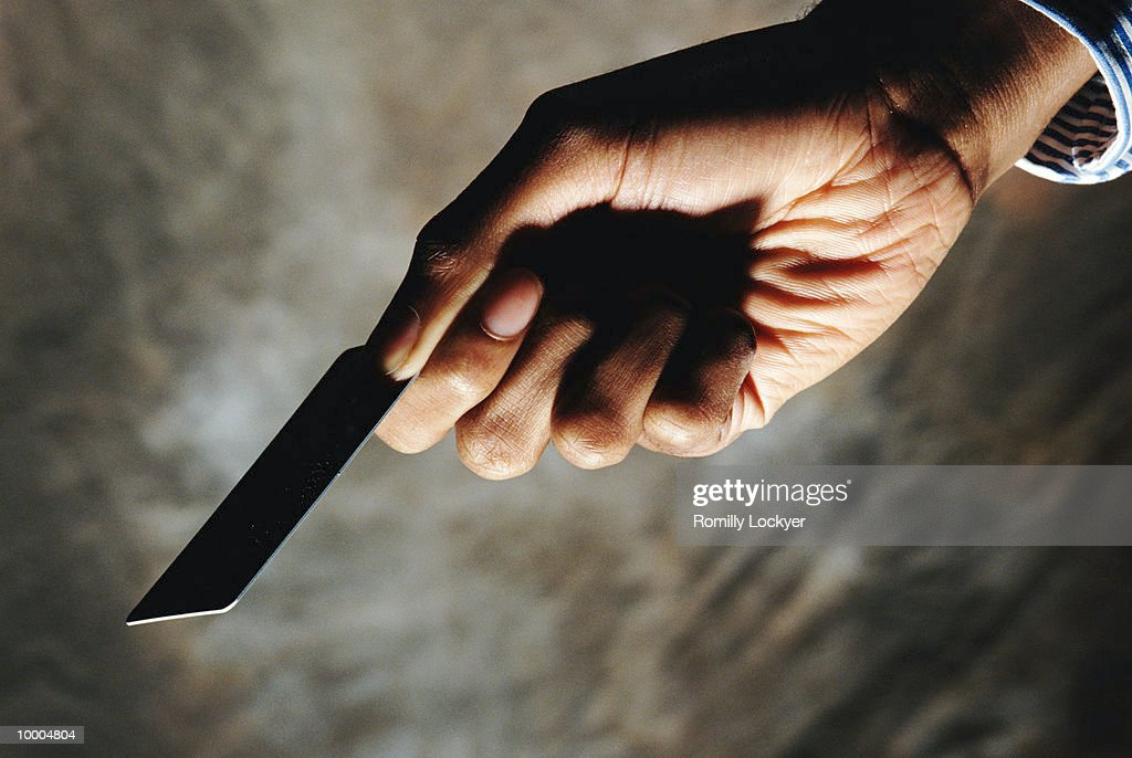 BLACK HAND HOLDING CREDIT CARD : Stock Photo