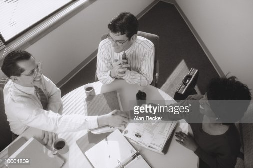 BUSINESSPEOPLE MEET WITH HANDSHAKE IN BLACK AND WHITE : Stock Photo
