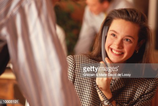 SMILING BUSINESSWOMAN ON PHONE LOOKING UP : Stock Photo