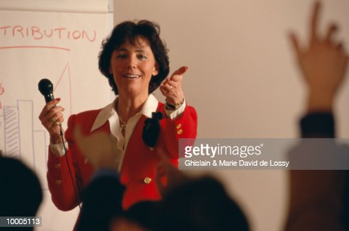 FEMALE SPEAKER FIELDING QUESTIONS : Stock Photo