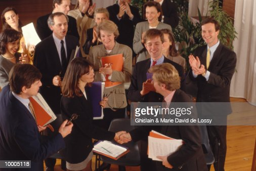 CONGRATULATING COUPLE AT BUSINESS MEETING : Stock Photo