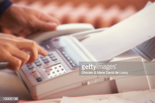 PERSON USING FAX MACHINE IN DETAIL : Stock Photo