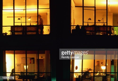 OUTSIDE VIEW INTO OFFICES AT NIGHT : Stock Photo
