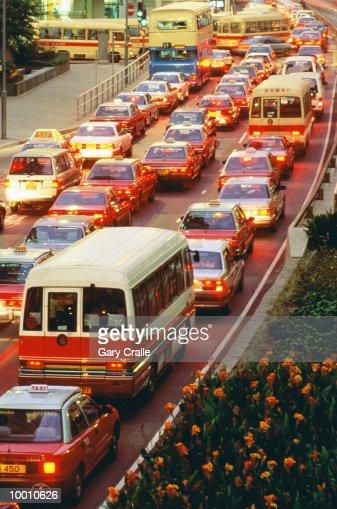 RUSH HOUR TRAFFIC AT DUSK IN HONG KONG : Stock Photo