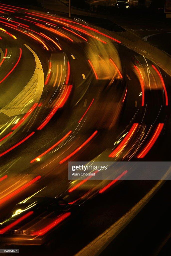 FREEWAY TRAFFIC AT NIGHT IN BLUR MOTION : Stock Photo