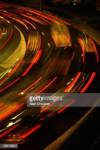 FREEWAY TRAFFIC AT NIGHT IN BLUR MOTION : Stock Photo