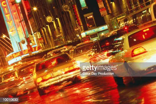 CITY TRAFFIC AT NIGHT IN NEW YORK IN BLUR : Stock Photo