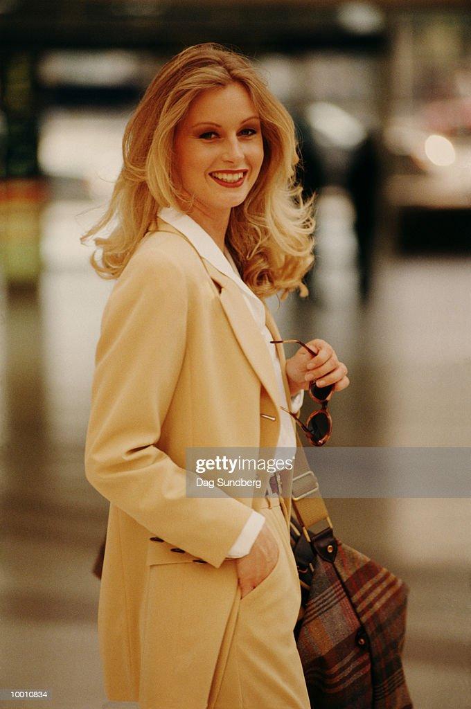 FASHIONABLE BLONDE WOMAN : Stock Photo