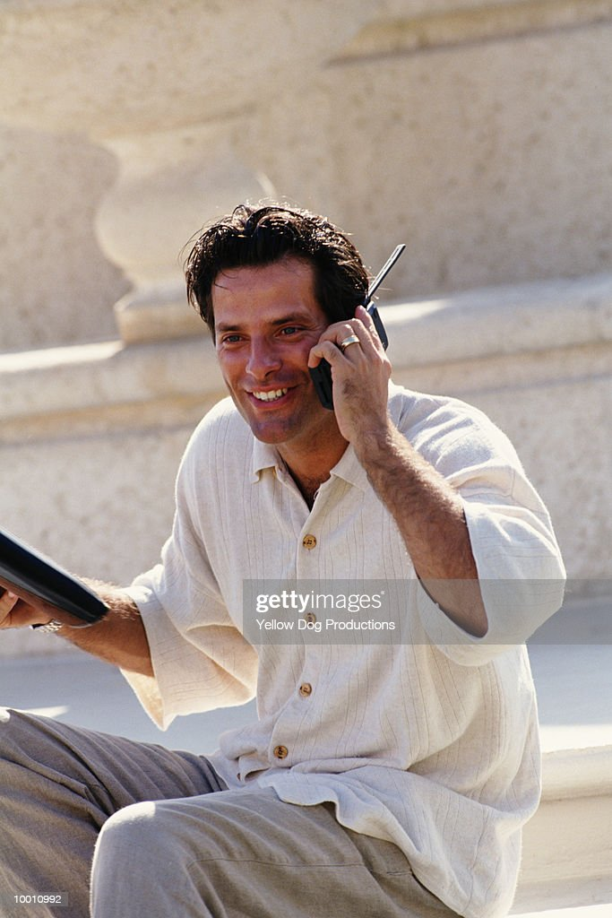 MAN WITH PHONE OUTDOORS : Stock Photo