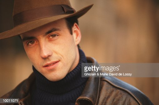 PORTRAIT OF A MAN IN HAT & LEATHER JACKET : Stock Photo
