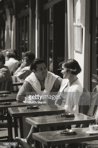 COUPLE AT OUTDOOR CAFE IN PARIS : Stock Photo