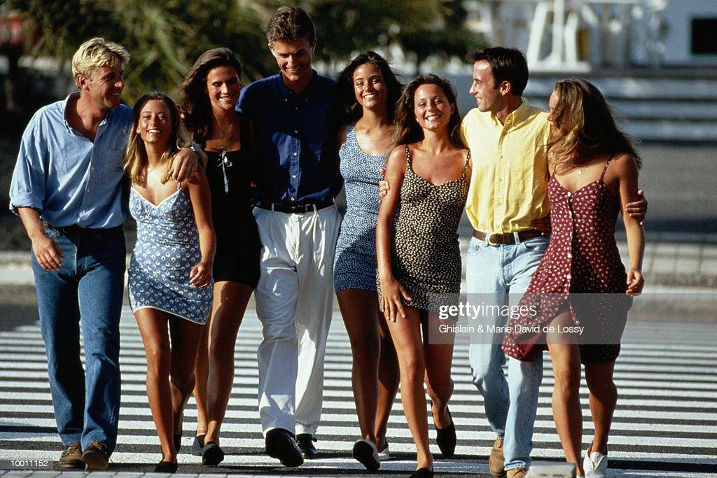 CASUAL PEOPLE CROSSING WALK : Stock Photo