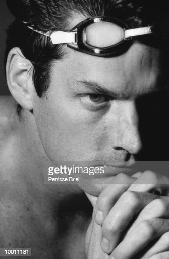 CLOSE-UP OF A YOUNG MALE SWIMMER IN BLACK AND WHITE : Stock Photo