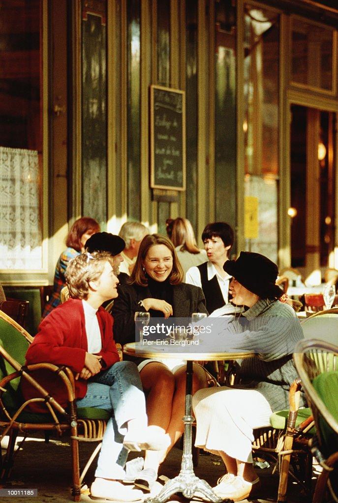 WOMEN ENJOYING DRINKS AT OUTDOOR CAFE : Stock Photo