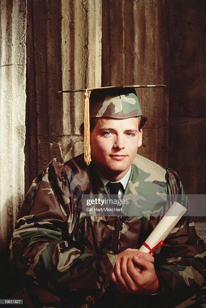 MALE GRADUATE IN CAMOUFLAGE CAP & GOWN : Stock-Foto
