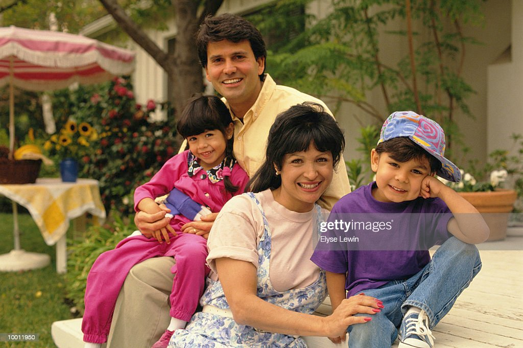 PORTRAIT OF A HISPANIC FAMILY ON BACK PORCH : Stock Photo
