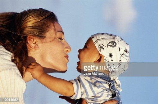 WOMAN LIFTING CHILD IN DETAIL : Foto de stock
