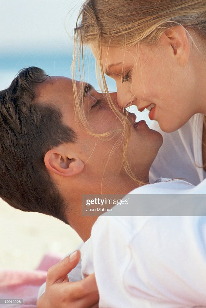 CLOSE-UP OF INTIMATE COUPLE : Stock Photo