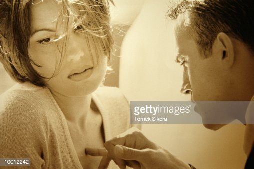 CLOSE-UP OF A MAN TOUCHING WOMAN'S CHEST : Foto de stock