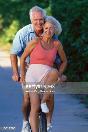 MATURE COUPLE ON BICYCLE : Stock Photo