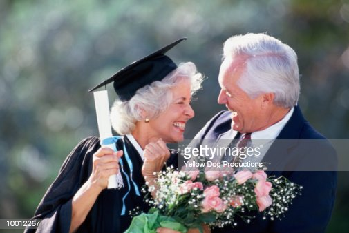 MATURE FEMALE GRADUATE WITH HUSBAND : Stock Photo