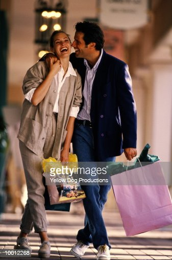COUPLE WITH SHOPPING BAGS IN MALL : Stock Photo