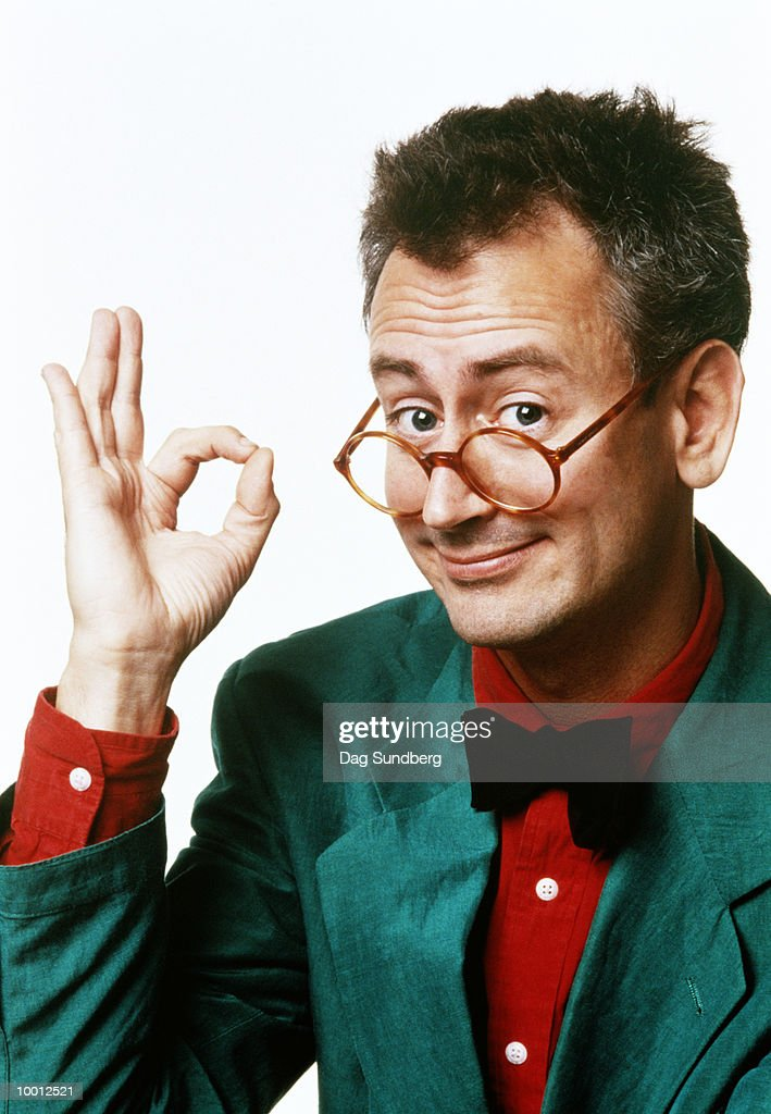 COMICAL MAN MAKING OK SIGN WITH HAND : Foto de stock