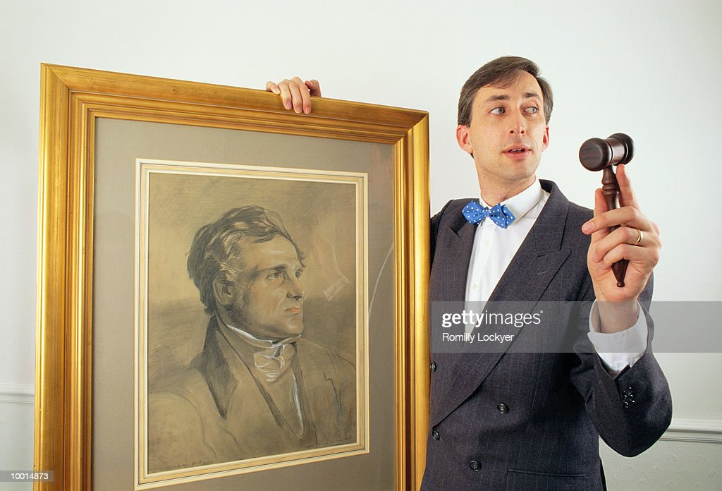 AUCTIONEER WITH GAVEL & OLD PAINTING