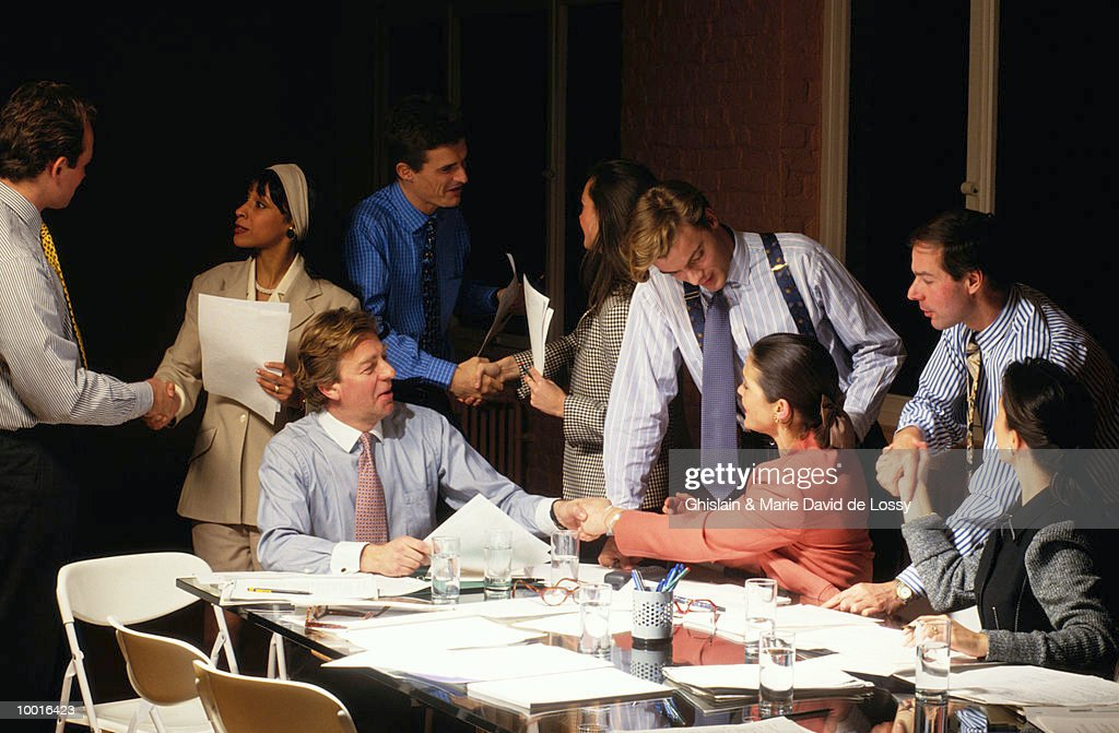 BUSINESS CO-WORKERS SHAKING HANDS : Stock Photo