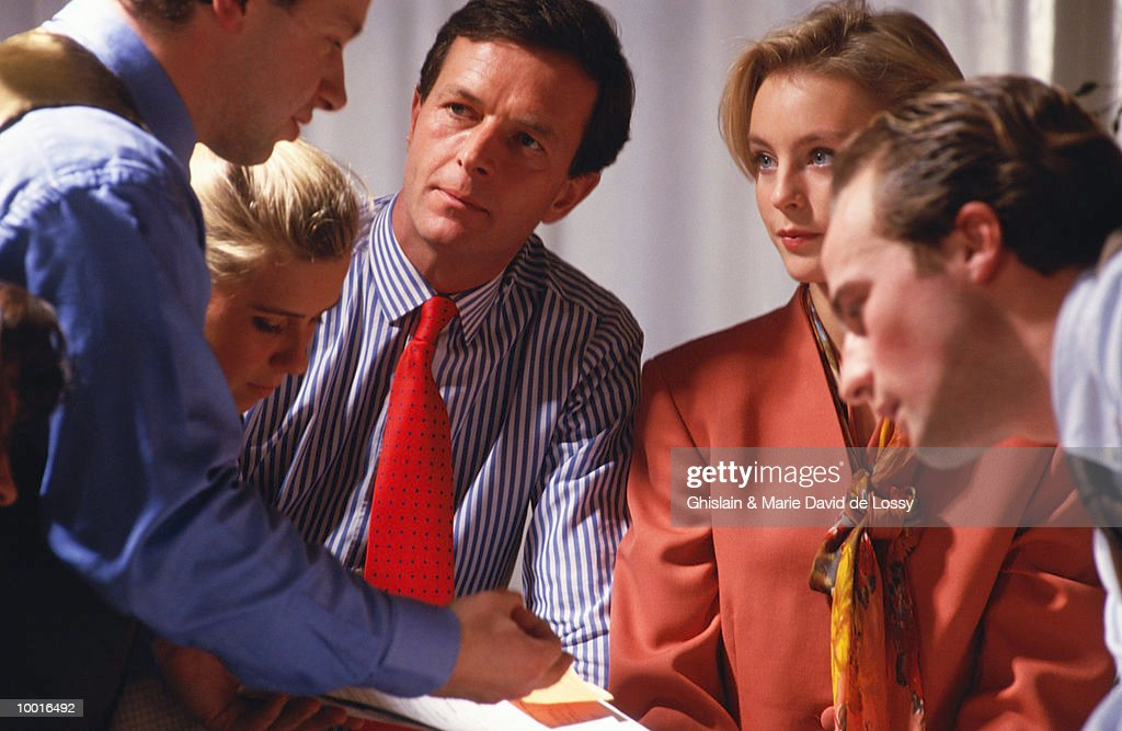 CO-WORKERS IN CONFERENCE : Stock Photo