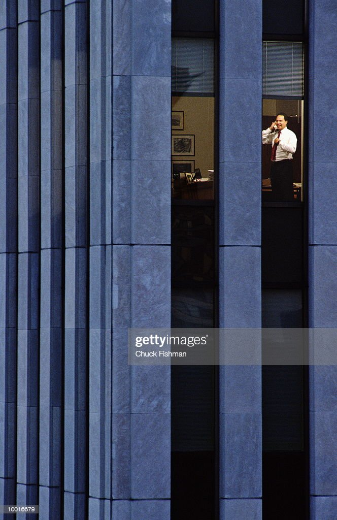 EXECUTIVE WORKING LATE IN OFFICE IN NEW YORK CITY : Stock Photo