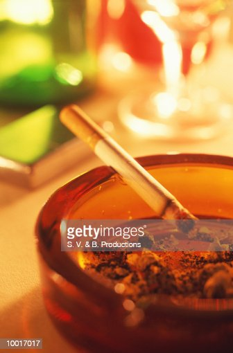 CLOSE-UP OF CIGARETTE IN ASHTRAY : Stock Photo