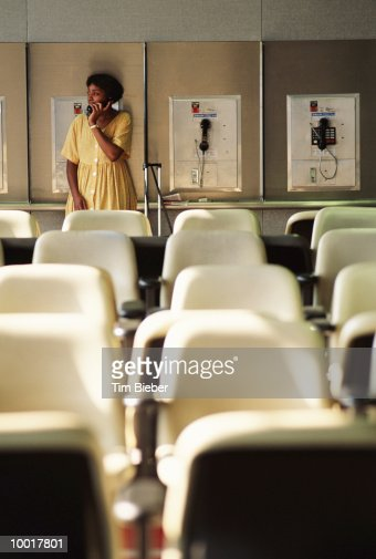WOMAN ON PAY PHONE AT O'HARE AIRPORT IN CHICAGO : Stock Photo
