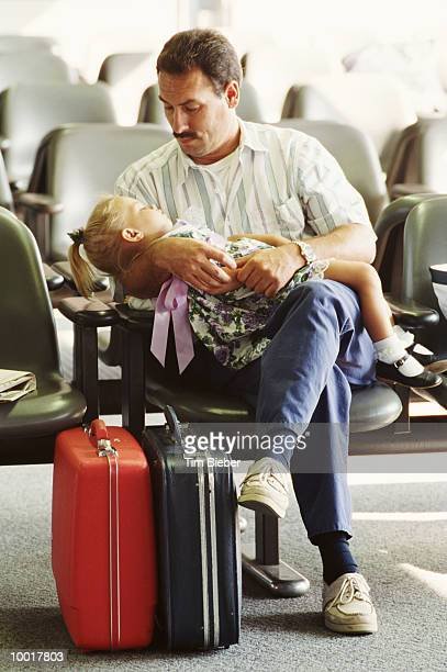 DAD WITH GIRL AT O'HARE AIRPORT IN CHICAGO, ILLINOIS