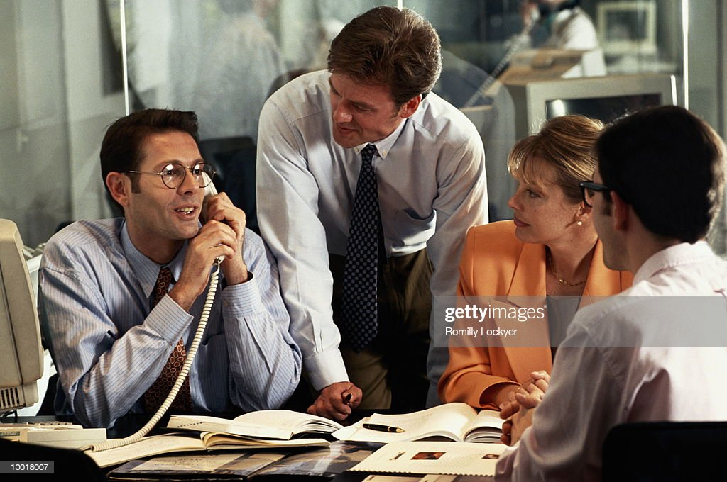 BUSINESS MEETING WITH MAN ON PHONE : Stock Photo
