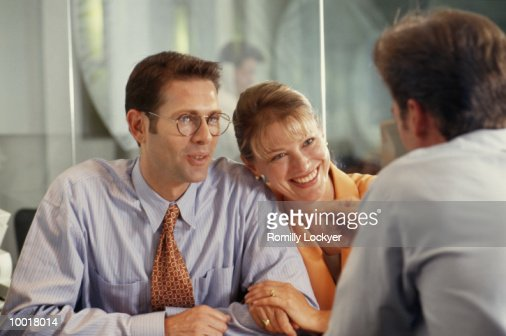 COUPLE MEETING WITH ADVISOR : Stock Photo