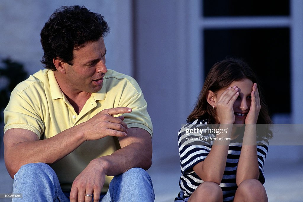 FATHER SCOLDING DAUGHTER : Stock Photo