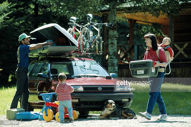 YOUNG FAMILY LOADING CAR FOR CAMPING IN NORTH CALIFORNIA