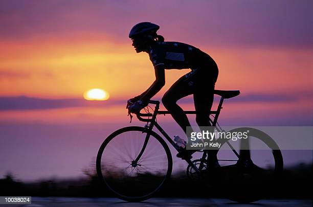 SILHOUETTE OF AN US CYCLING TEAM RIDER AT SUNSET IN SOUTH CALIFORNIA