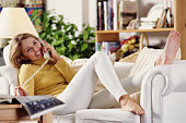 WOMAN AT HOME ON PHONE