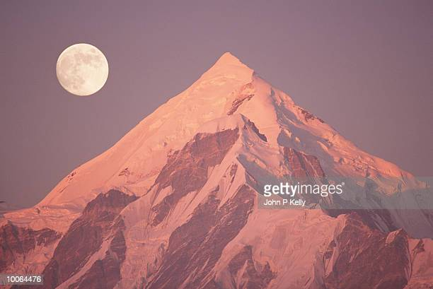 MOON OVER PANCH CHULI PEAK IN THE INDIAN HIMALAYAS