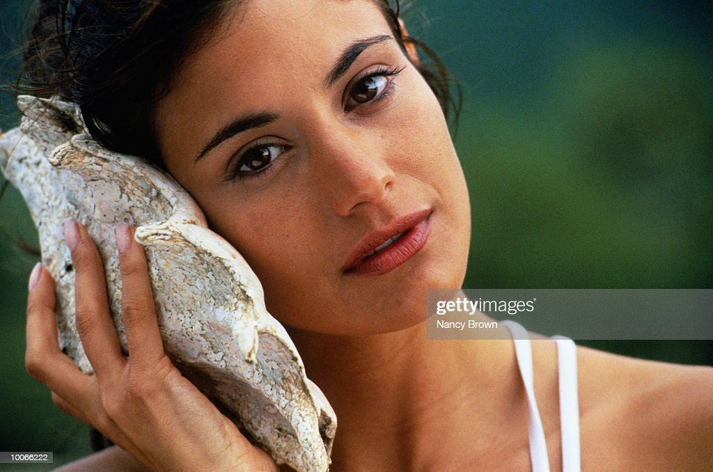 ETHNIC WOMAN HEAD SHOT WITH SHELL : Stock Photo