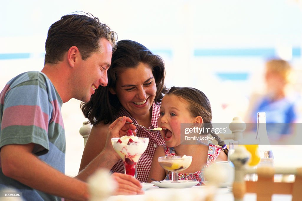 Family Eating Ice Cream Stock Photo | Getty Images