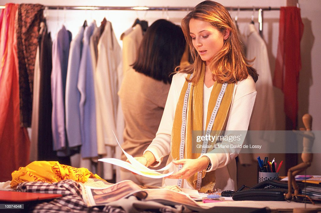 CLOTHES DESIGNER AT WORK : Stock Photo