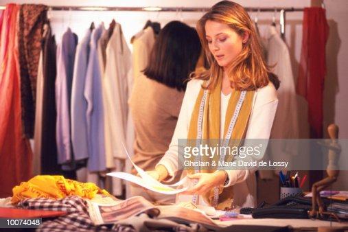 CLOTHES DESIGNER AT WORK : Stock Photo